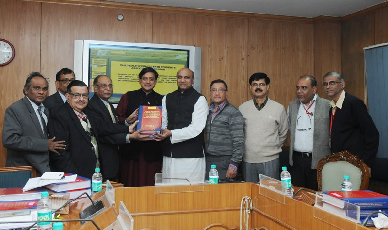 The Union Minister for Human Resource Development, Dr. M.M. Pallam Raju being presented a Report on a single legislation for central universities, in New Delhi on December 12, 2013. The Minister of State for Human Resource Development, Dr. Shashi Tharoor, the Secretary (Higher Education), Ministry of Human Resource Development, Shri Ashok Thakur and other dignitaries are also seen.
