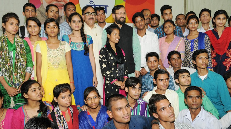 The Union Minister for Human Resource Development, Shri Prakash Javadekar in a group photograph with the students, who cleared XII with high marks and got admission to reputed colleges, at a function, in New Delhi on July 17, 2016. The Secretary, School Education and Literacy, Dr. Subash Chandra Khuntia is also seen.