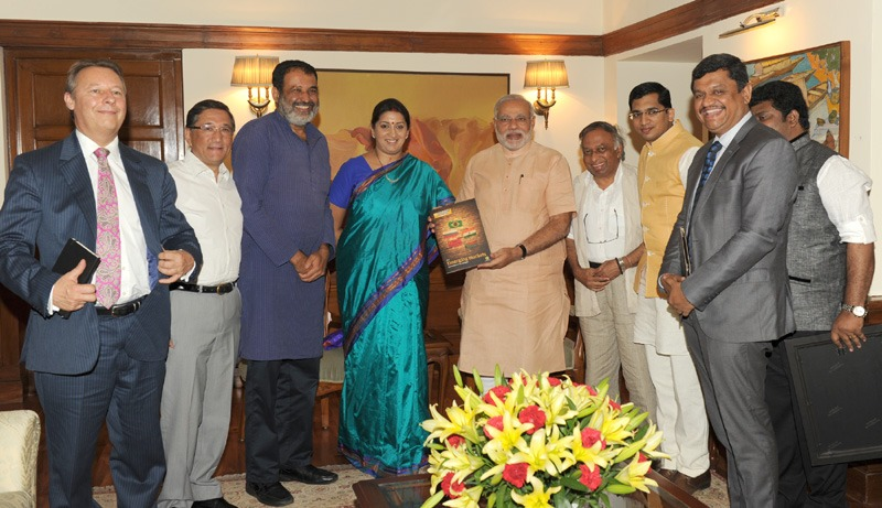 The Prime Minister, Shri Narendra Modi was presented the first copy of the QS BRICS 2014 University Rankings by the Union Minister for Human Resource Development, Smt. Smriti Zubin Irani and the Chairman Indian Centre for Assessment and Accreditation, Shri Mohandas Pai, at 7 Race Course Road, in New Delhi on June 17, 2014.
