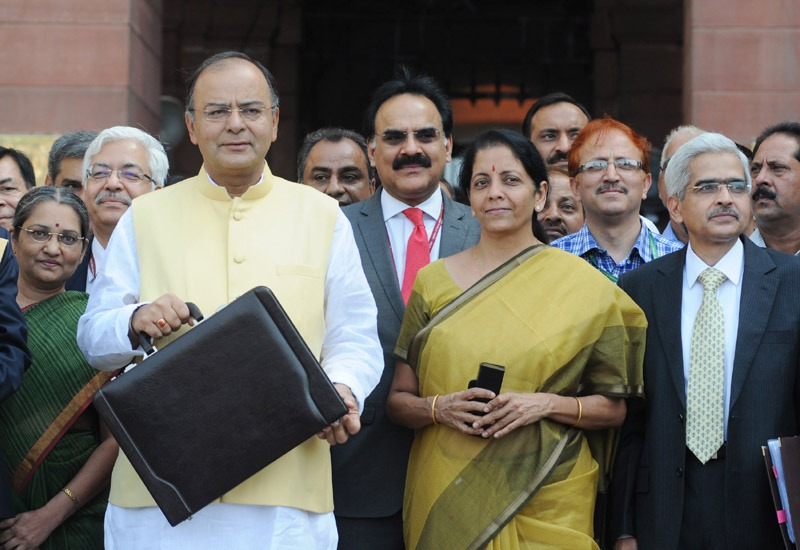 The Union Minister for Finance, Corporate Affairs and Defence, Shri Arun Jaitley departs from North Block to Parliament House along with the Minister of State for Commerce & Industry (Independent Charge), Finance and Corporate Affairs, Smt. Nirmala Sitharaman to present the General Budget 2014-15, in New Delhi on July 10, 2014.