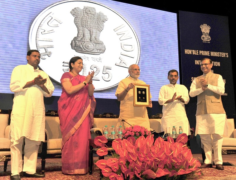 The Prime Minister, Shri Narendra Modi releasing the commemorative coins of Rs. 125 & Rs. 10 to mark the 125th birth anniversary of Dr. Sarvepalli Radhakrishnan, on eve of the Teachers' Day, at Manekshaw Centre, in New Delhi on September 04, 2015. The Union Minister for Human Resource Development, Smt. Smriti Irani, the Ministers of State for Human Resource Development, Prof. (Dr.) Ram Shankar Katheria and Shri Upendra Kushwaha and the Minister of State for Finance, Shri Jayant Sinha are also seen.
